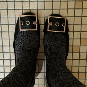 Gucci Black flats with gold buckles